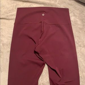 Lulu Lemon maroon crop leggings.